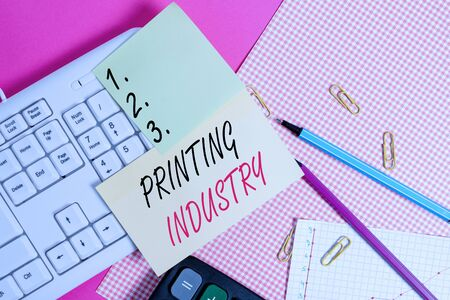 Text sign showing Printing Industry. Business photo showcasing industry involved in production of printed matter Note paper stick to computer keyboard near colored gift wrap sheet on table Stockfoto