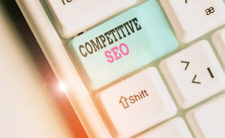 Writing note showing Competitive Seo. Business concept for the process of evaluating how the top rankings fare Stockfoto