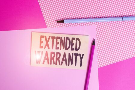 Conceptual hand writing showing Extended Warranty. Concept meaning contract which gives a prolonged warranty to consumers writing equipments and plain note paper placed on the table
