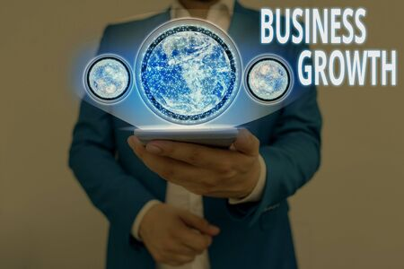 Writing note showing Business Growth. Business concept for process of improving some measure of an enterprise success Elements of this image furnished by NASA
