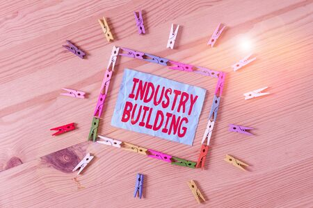 Conceptual hand writing showing Industry Building. Concept meaning Factories and other premises used for analysis manufacturing Colored crumpled papers wooden floor background clothespin