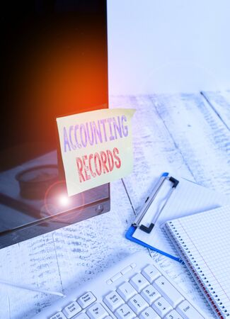 Handwriting text writing Accounting Records. Conceptual photo Manual or computerized records of assets and liabilities Note paper taped to black computer screen near keyboard and stationary