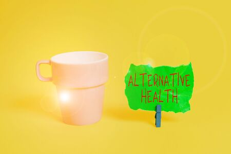 Conceptual hand writing showing Alternative Health. Concept meaning products and practices that are not part of standard care Paper blue clothespin rectangle shape reminder yellow office