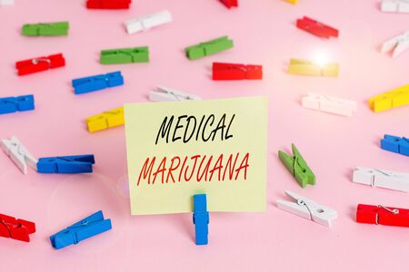Writing note showing Medical Marijuana. Business concept for recommended by examining as treatment of a medical condition Colored clothespin papers empty reminder pink floor office pin