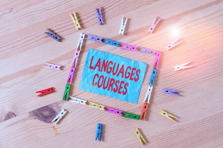 Conceptual hand writing showing Languages Courses. Concept meaning set of classes or a plan of study on a foreign language Colored crumpled papers wooden floor background clothespin 版權商用圖片