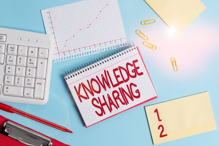 Word writing text Knowledge Sharing. Business photo showcasing deliberate exchange of information that helps with agility Paper blue desk computer keyboard office study notebook chart numbers memo 스톡 콘텐츠