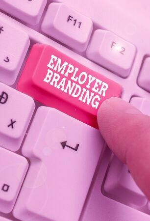 Writing note showing Employer Branding. Business concept for process of articulating your company unique message Stock Photo