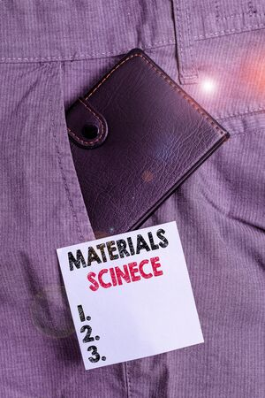 Handwriting text Materials Science. Conceptual photo interdisciplinary field involving the properties of matter Small little wallet inside man trousers front pocket near notation paper