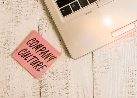 Word writing text Company Culture. Business photo showcasing pervasive values and attitudes that characterize a company Trendy metallic laptop blank sticky notes lying wooden rustic vintage table Standard-Bild - 139602523