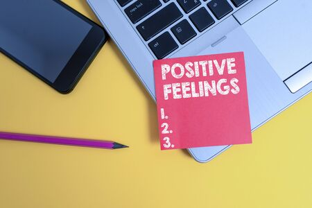 Handwriting text Positive Feelings. Conceptual photo any feeling where there is a lack of negativity or sadness Trendy laptop smartphone blank sticky note pencil marker colored background