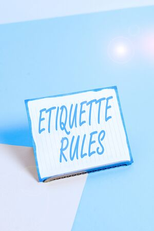 Conceptual hand writing showing Etiquette Rules. Concept meaning customs that control accepted behaviour in social groups Paper on buffer wire on soft pastel multi colours backdrop Banque d'images