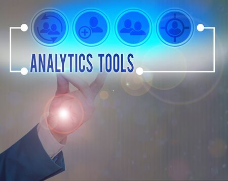 Writing note showing Analytics Tools. Business concept for pieces of web application analysis software used to monitor