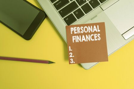 Handwriting text Personal Finances. Conceptual photo the activity of analysing own money and financial decisions Trendy laptop smartphone blank sticky note pencil marker colored background
