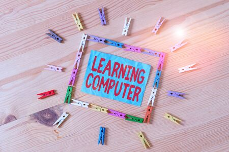 Conceptual hand writing showing Learning Computer. Concept meaning learn more about each of the components in the computer Colored crumpled papers wooden floor background clothespin Standard-Bild - 139603205