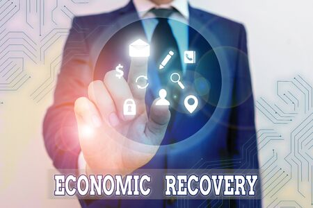 Conceptual hand writing showing Economic Recovery. Concept meaning rise of business activity signaling the end of a recession