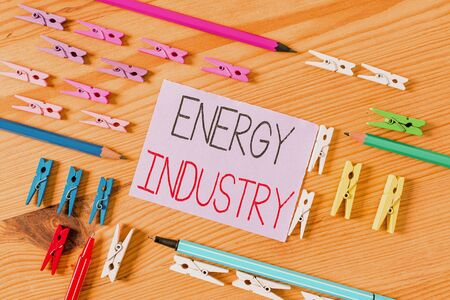 Text sign showing Energy Industry. Business photo text industries involved in the production and sale of energy Colored clothespin papers empty reminder wooden floor background office