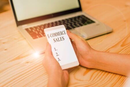 Word writing text E Commerce Sales. Business photo showcasing activity of buying or selling of products on online service Foto de archivo