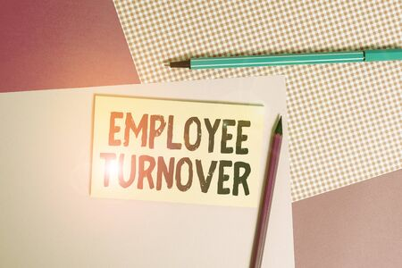 Conceptual hand writing showing Employee Turnover. Concept meaning the percentage of workers who leave an organization writing equipments and plain note paper placed on the table