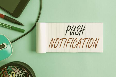 Conceptual hand writing showing Push Notification. Concept meaning automated message sent by an application to a user Notebook and stationary with gadgets above pastel backdrop Stock fotó