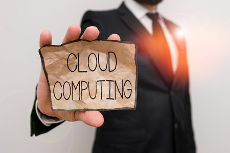 Text sign showing Cloud Computing. Business photo text storing and accessing data and programs over the Internet Male human wear formal work suit office look hold notepaper sheet use hand