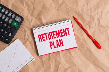 Handwriting text writing Retirement Plan. Conceptual photo plan for setting aside money to be spent after retirement Papercraft craft paper desk square spiral notebook office study supplies Banque d'images