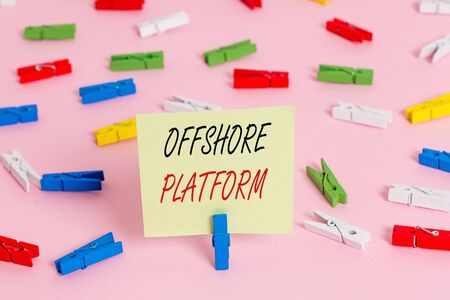 Writing note showing Offshore Platform. Business concept for structure with facilities for well drilling to explore Colored clothespin papers empty reminder pink floor office pin Imagens