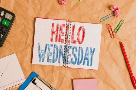 Handwriting text Hello Wednesday. Conceptual photo Hump day Middle of the working week of the calendar Papercraft craft paper desk square spiral notebook office study supplies