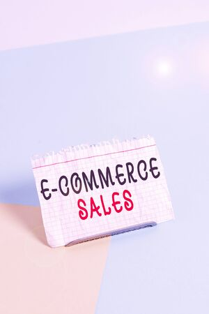 Text sign showing E Commerce Sales. Business photo text activity of buying or selling of products on online service Paper placed tilted above buffer wire on soft pastel multi colours backdrop