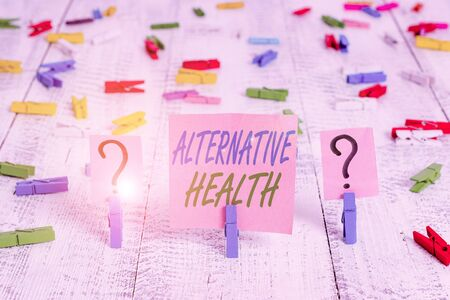 Word writing text Alternative Health. Business photo showcasing products and practices that are not part of standard care Scribbled and crumbling sheet with paper clips placed on the wooden table Zdjęcie Seryjne