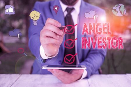 Text sign showing Angel Investor. Business photo showcasing high net worth individual who provides financial backing Stock Photo