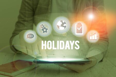 Writing note showing Holidays. Business concept for an extended period of leisure and recreation spent away from home
