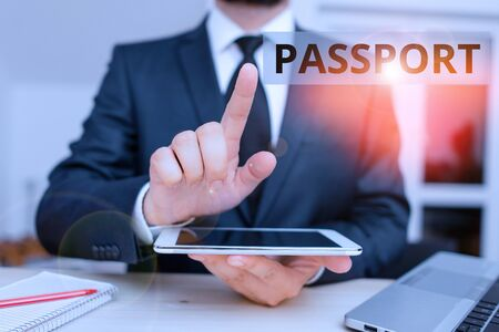 Text sign showing Passport. Business photo showcasing official document issued by a government certifying the identity Male human wear formal clothes present presentation use hi tech smartphone Foto de archivo