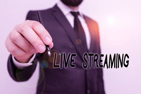 Conceptual hand writing showing Live Streaming. Concept meaning media simultaneously recorded and broadcast in real time Male human with beard wear formal working suit clothes hand