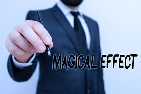 Conceptual hand writing showing Magical Effect. Concept meaning produced by or as if by magic a magical transformation words Male human with beard wear formal working suit clothes hand 스톡 콘텐츠