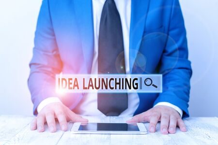 Text sign showing Idea Launching. Business photo showcasing to begin something new such as a plan or business venture Businessman in blue suite with a tie holds lap top in hands