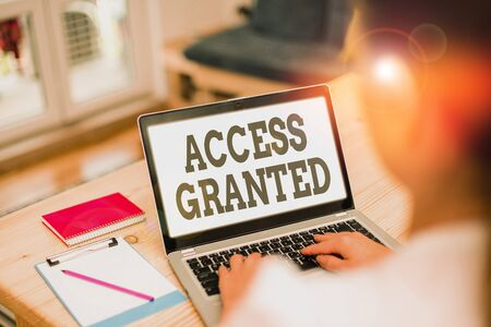 Handwriting text Access Granted. Conceptual photo admittance of users to system and network resources
