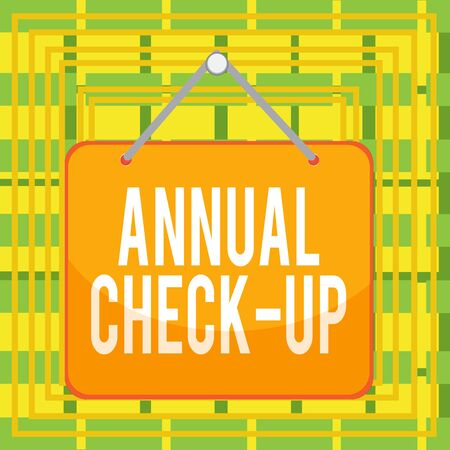 Text sign showing Annual Check Up. Business photo text a thorough physical medical examinantion held every year Colored memo reminder empty board blank space attach background rectangle