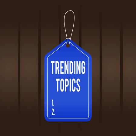 Writing note showing Trending Topics. Business concept for subject that experiences surge in popularity on social media Empty tag colorful background label rectangle attach string