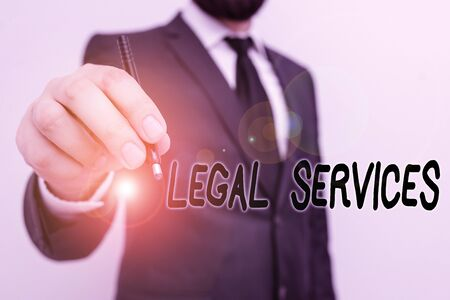 Conceptual hand writing showing Legal Services. Concept meaning any services involving legal or law related matters Male human with beard wear formal working suit clothes hand