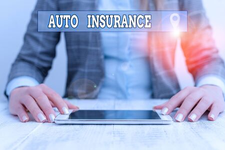 Text sign showing Auto Insurance. Business photo showcasing mitigate costs associated with getting into an auto accident Business woman sitting with mobile phone on the table