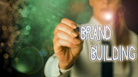 Conceptual hand writing showing Brand Building. Concept meaning activities associated with establishing and promoting a brand
