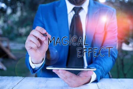 Conceptual hand writing showing Magical Effect. Concept meaning produced by or as if by magic a magical transformation words Businessman pointing with pen in empty copy space Фото со стока - 139906456