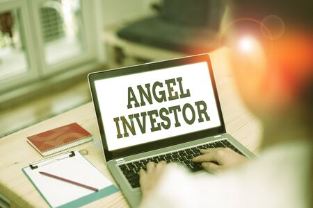 Handwriting text Angel Investor. Conceptual photo high net worth individual who provides financial backing Stock Photo