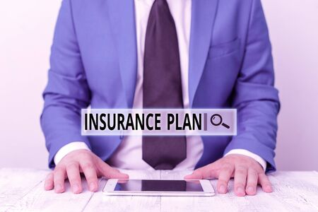 Text sign showing Insurance Plan. Business photo showcasing something showing buy to protect themselves from losing money Businessman in blue suite with a tie holds lap top in hands Reklamní fotografie