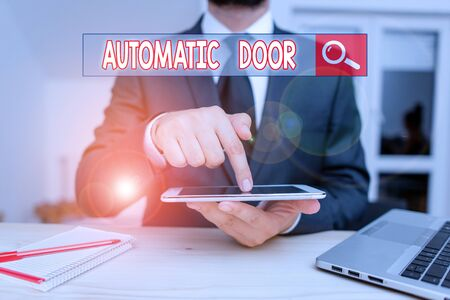 Handwriting text Automatic Door. Conceptual photo opens automatically when sensing the approach of person Male human wear formal clothes present presentation use hi tech smartphone