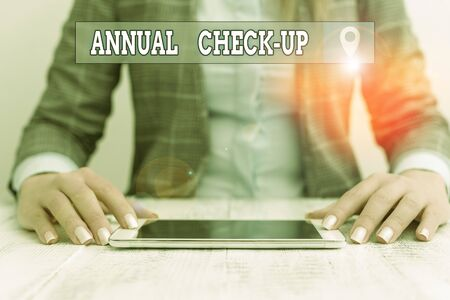 Text sign showing Annual Check Up. Business photo showcasing a thorough physical medical examinantion held every year Business woman sitting with mobile phone on the table