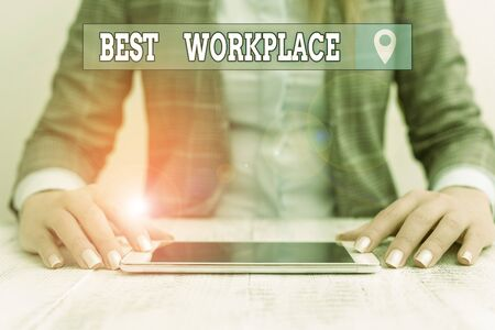 Text sign showing Best Workplace. Business photo showcasing helps employees to grow individually Promotes meritocracy Business woman sitting with mobile phone on the table