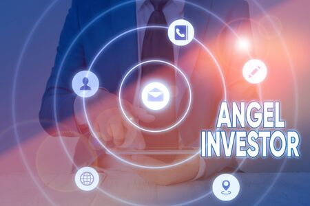 Writing note showing Angel Investor. Business concept for high net worth individual who provides financial backing
