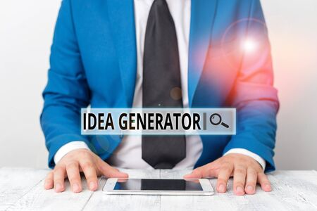 Text sign showing Idea Generator. Business photo showcasing process of creating developing and communicating ideas Businessman in blue suite with a tie holds lap top in hands