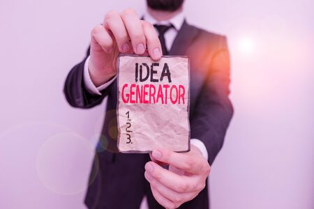 Text sign showing Idea Generator. Business photo showcasing process of creating developing and communicating ideas Male human wear formal work suit office look hold notepaper sheet use hand